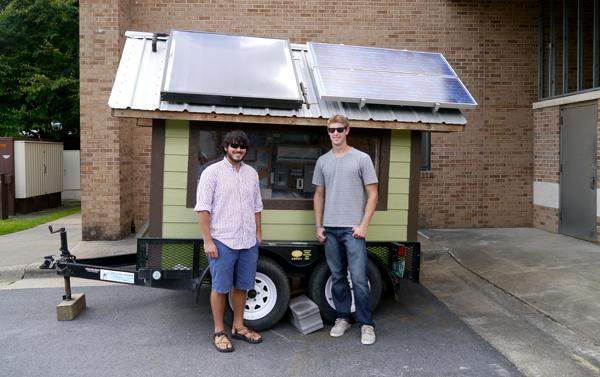 Grant Warner and Nick Hoit, president and vice president of the Solar Club, stand with DAISEE, a power-generating trailer. Warner and Hoit are hoping to use the trailer this weekend to supply a portion of the energy for stage performances at Music on the Mountaintop. Conor McClure | The Appalachian