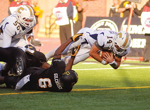 Freshman outside linebacker Kennan Gilchrist attempts to stop Chattanooga quarterback Jacob Heusman from scoring a touchdown. The Mountaineers fell to the Mocs 25-28 at home, making this the Mocs first win in Mountaineer territory since 1983. Photo by Justin Perry     The Appalachian